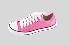 Pink sport shoe. On gray background Royalty Free Stock Photo
