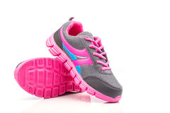 Pink sport shoe isolated on white background Stock Photos