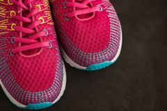 Pink sport shoes. Sneakers on a black background. Top view. Close Up stock image