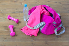 Pink sports bag and sports items. Sports equipment out of the bag Stock Images