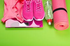 Pink sportswear for fitness, on a light green background Royalty Free Stock Photography