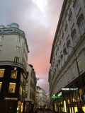 Pink spring sky over Vienna. Kartner posh shopping street troubles Stock Images