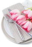 Pink spring tulips, fork and knife Stock Photography