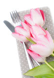 Pink spring tulips, fork and knife Royalty Free Stock Image