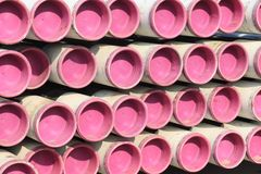Pink stacked pipes. At an industrial storage royalty free stock photos