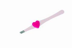 Pink stainless steel grooming tweezers Royalty Free Stock Image