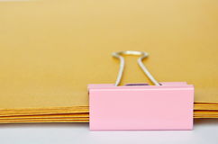 Pink stamp paper clip on brown envelop overlay Stock Image