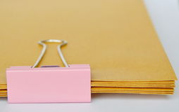 Pink stamp paper clip on brown envelop overlay Royalty Free Stock Image