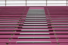 Pink stands at football stadium Stock Photos