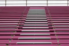 Pink stands at football stadium Stock Photos