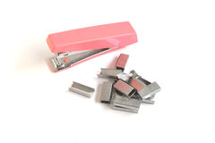 The pink stapler lies Stock Photography