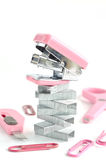 Pink stapler with office accessories Stock Photos