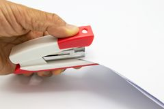Pink stapler and paper document stock photography