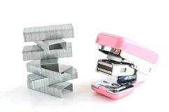 Pink stapler with staples stack stock photos