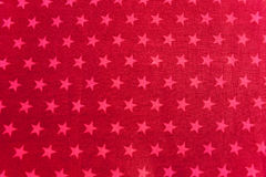 Pink stars on red background Stock Photo