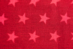 Pink stars on red background Stock Images