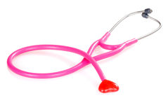 Pink stethoscope with candy heart Stock Images