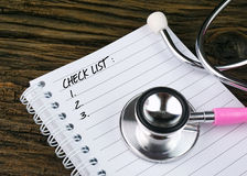 Pink Stethoscope And Open Notebook With Text Stock Image