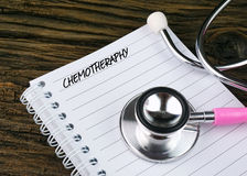 Pink Stethoscope And Open Notebook With Text Royalty Free Stock Image