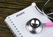 Pink Stethoscope And Open Notebook With Text Stock Photo