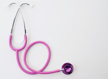 Pink stethoscope on white Royalty Free Stock Photography