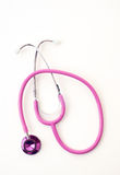 Pink stethoscope on white Stock Images