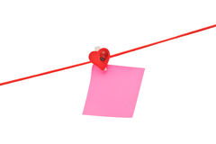 Pink sticky hanged on red rope Stock Photo