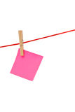 Pink sticky hanged on red rope Stock Images