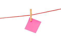 Pink sticky hanged on red rope Royalty Free Stock Photo