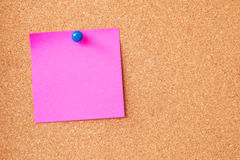 Pink sticky notes on cork board Stock Images