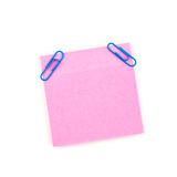 Pink sticky paper note with blue clips Royalty Free Stock Images