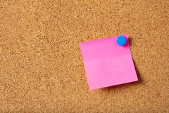 Free Pink Sticky Single Note With Blue Pushpin And Blank Space, Isolated On Cork Background. Stock Photos - 121434133