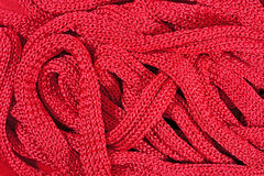 Pink stockinet ribbons background Stock Photos