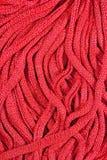 Pink stockinet ribbons background Stock Image