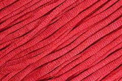 Pink stockinet ribbons background Stock Photography