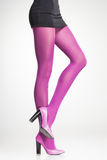 Pink stockings on sexy woman legs  on grey. Background Stock Photography