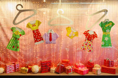 Pink storefront with gifts and paper clothing Royalty Free Stock Photography
