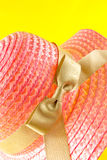 Pink straw bonnet Stock Photo