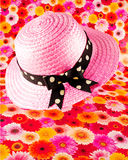 Pink straw bonnet Royalty Free Stock Photos