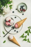 Pink strawberry and coconut ice cream waffle scoops, top view Stock Photography