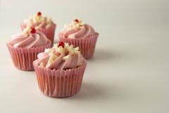Pink, strawbery, fruit cupcakes isoalted. Sweet dessert, shortcakes with cream. Birthday food, cake, muffin. Pink, strawbery, fruit cupcakes isoalted. Sweet royalty free stock photos