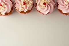 Pink, strawbery, fruit cupcakes isoalted. Sweet dessert, shortcakes with cream. Birthday food, cake, muffin. flat lay, copy space. Pink, strawbery, fruit stock photos
