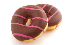 Pink striped donuts with chocolat Stock Photos