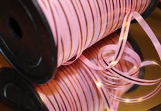 Pink striped ribbon for your present Royalty Free Stock Images