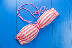 Pink striped swimsuit Stock Image