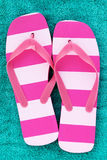 Pink Stripped Flip Flops. On Teal Towel Royalty Free Stock Images
