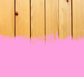 Pink stroke of paint brush on wooden background Royalty Free Stock Photos