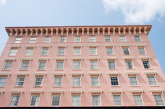 Many Windows in Pink Stucco Hotel Royalty Free Stock Image