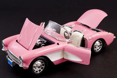 Pink stylish classic sports car. Picture of a pink beautiful classic muscle car Stock Photos