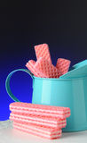 Pink Sugar Wafers in Blue Tin Stock Photos